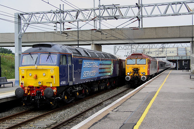 8 July. Having deposited her passengers at Milton Keynes, 47805 sits on the rear of the Northern Belle as 57311 Parker approaches hauling 390032 City of Birmingham as the 5A16 0842 Oxley - Euston.
