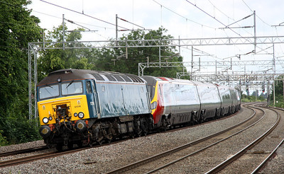 1 July. Arriva plain blue 57316 with 390013 Virgin Spirit in tow pass Wolverton with the 5A16 0842 Oxley - Euston.