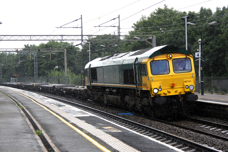 7 July. During a downpour, ex Freightliner but now GB operated 66741, the ex 66581 passes Wolverton on the 4Z97 Hams Hall - Tonbridge.