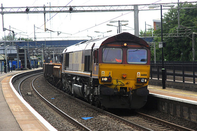 1 July. 66188 passes Wolverton heading the 6R01 Denbigh Hall Junction - Bescot.