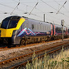 25 July. First Hull Trains 180111 flies north at Langford working the 1850 Kings Cross - Hull.