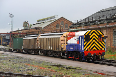 6 July. Resident shunter 08649 Wolverton is seen in the works marshalling the barriers for a class 332 move.
