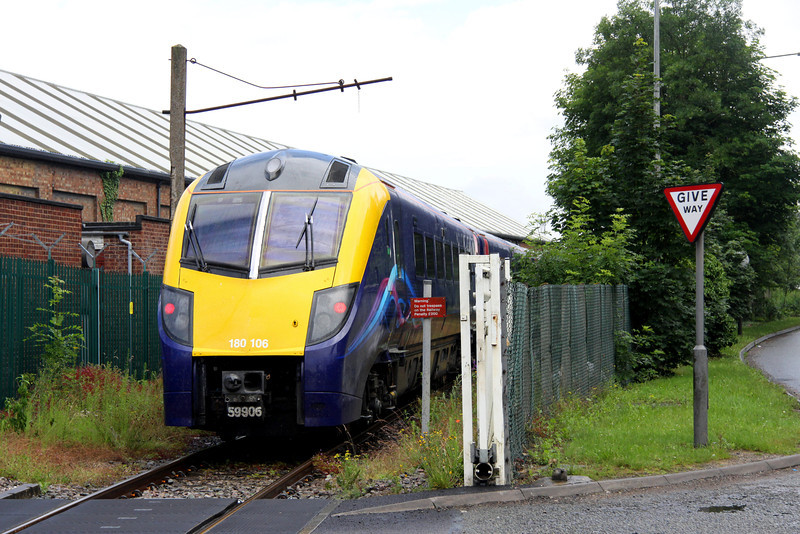 6 July. With a crudely applied number on her coupler Adelante 180106 crosses the distribution crossing along McConnell Drive as she leaves Wolverton Works heading to Old Oak Common as the 5Z80.