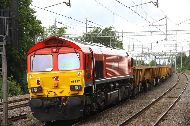 1 July. DBS liveried 66152 Derek Holmes Railway Operator was tail loco on 6R01 at Wolverton.