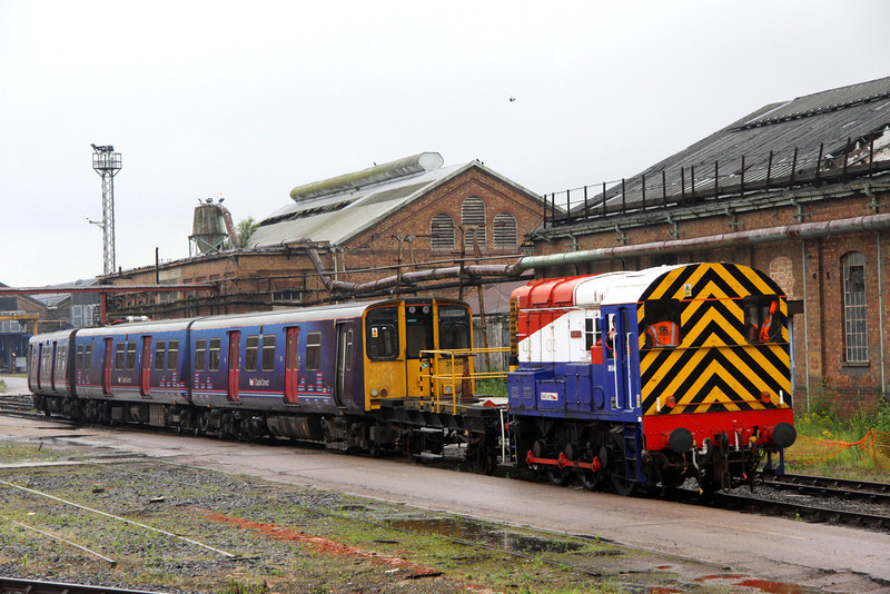 6 July. 08649 Wolverton drags the final FCC 313 unit for refurbishment, 313049 through Wolverton Works. The 313 will then run as 5Z25 to her home depot at Hornsey.