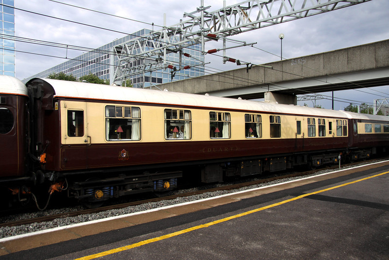 8 July. During the Silverstone F1 Grand Prix the Northern Belle was stabled at Daventry. The ECS is seen here back at Milton Keynes with vehicle 325 DUART in the formation. This vehicle spent most of its life as a Royal Train vehicle numbered 2907.