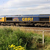 27 July. A broadside view of 66710 Phil Packer BRIT passing Chelmscote on the 4L22 1521 Hams Hall - Felixstowe.