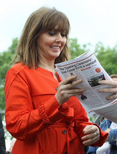 2 June. As patron of the Battle of Britain Memorial Flight, Carol Vorderman assisted in the naming of 91110. She is seen here after the naming signing autographs for the crowds.