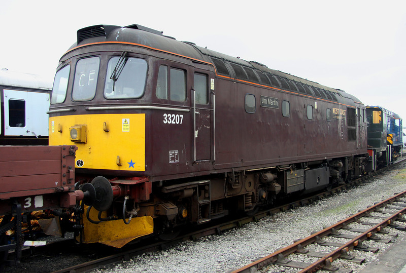 2 June. The arrangement of exhibits at Railfest 2012 was very poor and that is being kind !! A prime example being 33207 Jim Martin seen here completely boxed in on three of four sides.