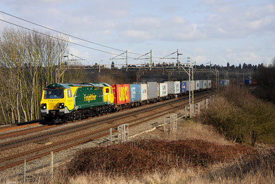 3 March. 20/20 vision as brand new 70020 strides through the shadows working the 4M20 1009 Felixstowe - Crewe Basford Hall past Chelmscote.
