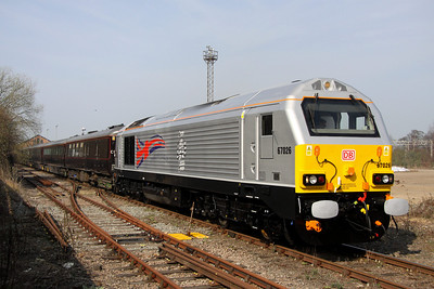 23 March. With the main WCML visible to the right of view, 67026 Diamond Jubilee trails the Royal Train ECS into Wolverton Works.