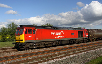 11 May. A fuller broadside view of 60007 showing the Switch on to Safety branding.