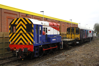 4 May. Whilst the distribution crossing gates are being closed, 08649 Wolverton comes to a stand with 313041.