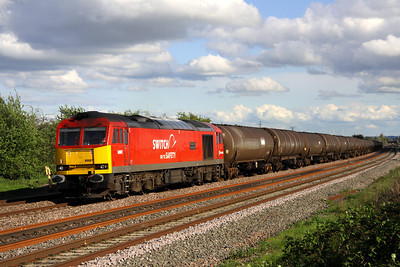 11 May. In full DBS colours with Switch on to Safety promotional branding, 60007 The Spirit of Tom Kendell arcs past Oakley with 6E38 1354 Colnbrook - Lindsy empty tanks. She had been named on 7 September 2011.