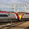 20 October. With 390043 Virgin Explorer in tow, 57308 TIN TIN departs from Crewe with the 0850 Euston - Holyhead.
