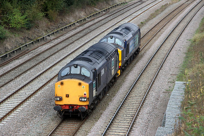 13 October. Having worked south the previous Saturday on a test train, 37606 + 37038 are seen passing Oakley working light together as the 0Z37 0805 Hither Green - Derby RTC.