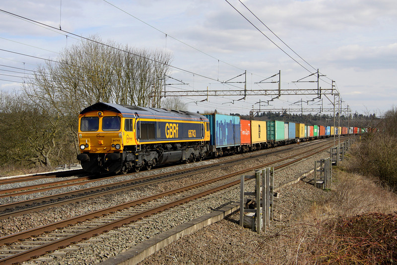 5 April. Having been after 66743 in sun for a while, happily fruition arrives. The former 66407 and 66842 passes Chelmscote with 4M23 1045 Felixstowe - Hams Hall.