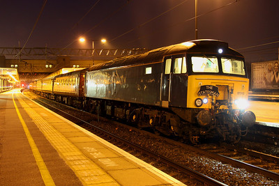 13 April The Cumbrian Mountain & Coast Express Statesman awaits her passengers at Milton Keynes just after 0500 with 57313 at the business end. The tour departed as the 1Z62 0538 MK - Carlisle.