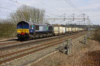 5 April. Former Fastline loco 66305 leads the 4M71 1129 Purfleet - Daventry at Chelmscote.