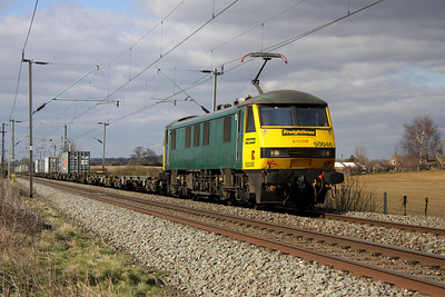5 April. Lightly loaded 4L90 1221 Crewe - Felixstowe heads south at Milton Malsor behind 90046.