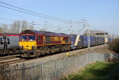 20 April. 66143 overtakes a slowing pendolino at Bradwell with the 4Z57 Hams Hall - Dollands Moor conveying UNIT 45 boxes.
