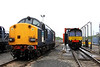 17 Aug. Through the the north end of the site sees 37038 which still carries the original DRS livery, next to 66432 passing through the washer.