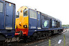 17 Aug. The forecasted downpour has now arrived and 20309 with her side doors open sits having a soak at Kingmoor.