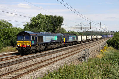 2 Aug. Following the recent derailment at Purfleet, the 4M71 1129 Purfleet - Daventry has required two locos which top and tail before departure from the Essex terminal. 66421 heads bodysnatcher 57011 past Chelmscote with a healthy load.