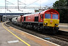 3 Aug. The latest DB 66 to gain DB red is 66185, seen at Wolverton working the 6M34 1240 Acton - Peak Forest.