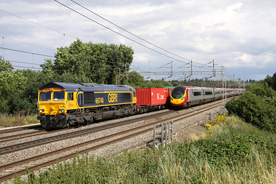 3 Aug. Phew... that was a little close. With 390157 Chad Varah exiting the shot at crawling pace, recently repainted 66740 takes a delayed 4M23 Felixstowe - Hams Hall past Chelmscote. All trains were either delayed or cancelled due to a fatality at Milton Keynes who was hit by 86628 + 86639 working the 4M12 Tilbury - Crewe.