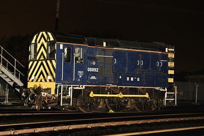 6 Dec. Carrying a dark blue livery, 08892 which has recently been located at Nemesis Rail at Burton is seen at the far end of the yard.