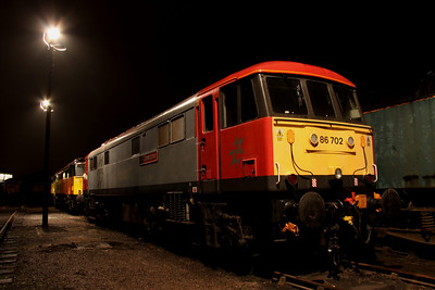 6 Dec. Carrying the attractive ETL colours of grey and red, 86702 Cassiopeia is caught under the yard lights. She was formerly 86260 Driver Wallace Oakes GC.