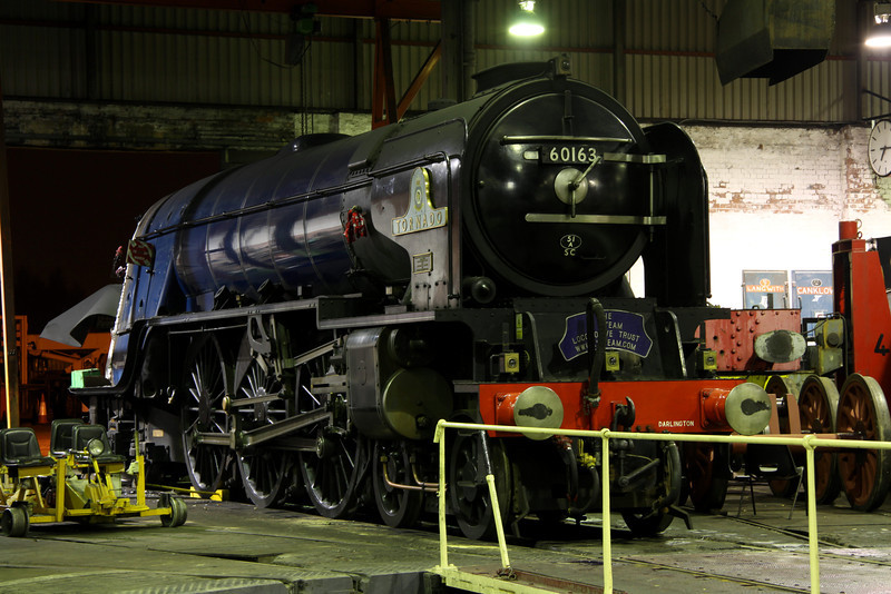 6 Dec. 60163 TORNADO is seen at the Barrow Hill Night Shoot undergoing an intermediate overhaul. Note she is split from her tender and also her cab has been removed.