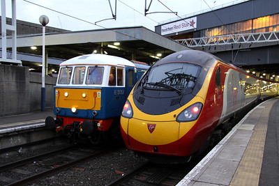 16 February. Old and new at Euston. 86259 Les Ross awaits an 0706 departure time with the Winter Cumbrian Mountain Express to Carlisle whilst 390135 City of Lancaster will work the 0723 to Wolverhampton.