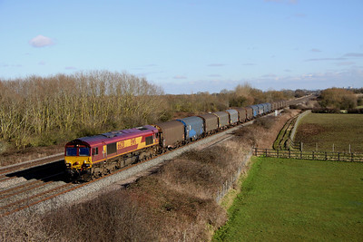 2 February. 66120 bowls slowly along the GW mainline at Denchworth working as the 6V13 0812 Dollands Moor - Margam empty steel.