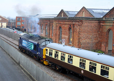 12 Janaury. Having passed under Stratford Road bridge, 37425 clears her throat heading for Haversham Bank. The buildings to the right were formerly home to Permagon Press, owned by the late Sir Robert Maxwell.