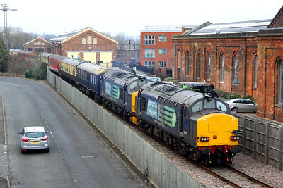 12 January. Having run round at Stafford, 37611 is seen paired with failed 37259 on the rear of 1Z34 as it heads for Haversham Bank. The building in the distance with the cream doors was the former Royal Train shed, now converted to housing.