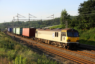 6 July. On day six of GB class 92 usage on intermodal workings, 92043 Debussy complete with Europorte branding takes the 4M01 0148 Felixstowe - Trafford Park past Old Linslade.