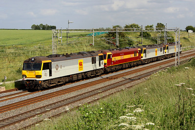 1 July. Three hundred and sixty eight - or 4 x 92 as heading away from camera 92029 Dante leads 92037 Sullivan  + 92001 Victor Hugo + 92019 Wagner past Castlethorpe as the 0A06 1335 Crewe IEMD - Wembley. Note that 92001 is devoid of third rail shoegear due to her being sent to work abroad.