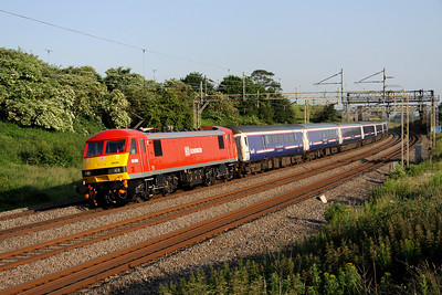 6 July. Fresh from her recent repaint into DB red, 90036 trawls the 1M16 2047 Inverness - Euston sleeper past Old Linslade.