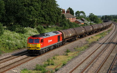 5 July. Refurbished tug 60017 takes the 6E38 1354 Colnbrook - Lindsey empty tanks past Oakley.