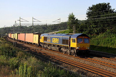 6 July. 66715 VALOUR passes north at Old Linslade working the 4M21 0323 Felixstowe - Hams Hall.