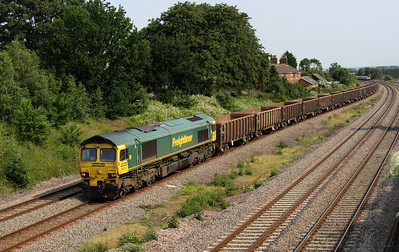 5 July. 66603 powers past Oakley with the 6D45 1558 Luton - Mountsorrel empties.