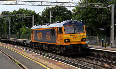 1 July. On the first day of a trial to use 92 traction on 4L18, sole GBRf liveried 92, 92032 IMechE Railway Division passes through Wolverton with the 1418 Trafford Park - Felixstowe.