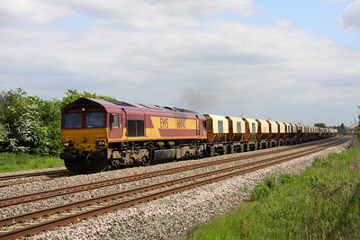 1 June. Dancing with the shadows 66043 passes Oakley with the 6D32 1358 Elstow - Mountsorrel.