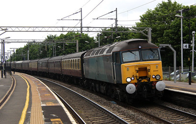 11 June. Ronnie 57315 passes the gloom of Wolverton with the 5Z46 0635 Bo'Ness - Southall ECS.