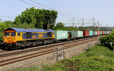 7 June. Until now my nemesis GB66, 66732 GBRf The First Decade 1999-2009 John Smith - MD passes Chelmscote working the 4M23 1045 Felixstowe - Hams Hall. Note the passing freight behind 66732 involving two FL 86/6's, one of which is visible between the first two containers on M23.