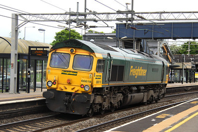 8 June. Running light to Bletchley to work the drain train, 66619 Derek W Johnson MBE passes Wolverton working as the 1548 Crewe Basford Hall - Bletchley Cambridge Sidings.