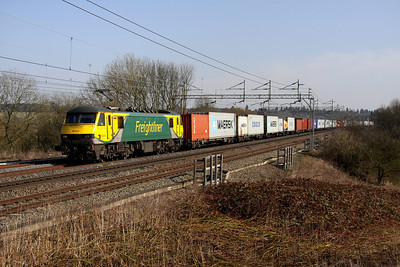 5 March. PowerHaul 90049 glides through Chelmscote with a well laden 4M81 0730 Felixstowe - Crewe.