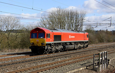 12 March. DBS red 66101 heads light past Chelmscote running as 0B41 to Daventry for the vans.